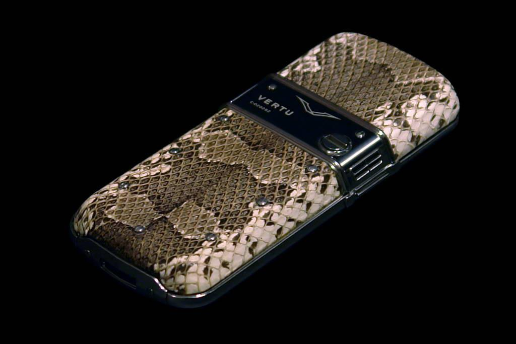VERTU CONSTELLATION EXOTIC LEATHER LIMITED EDITION by MJ VIP Mobile Phone Black Gold. Genuine Leather - Python Skin. Inlaid Jeweler Gems.